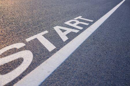 start line: Closeup photo of Start Line on the road. Stock Photo