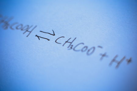 equation: Closeup picture of chemical equation written on the paper.