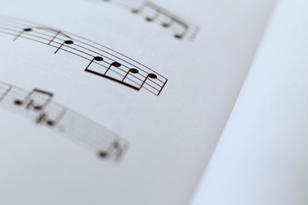 octaves: Closeup picture of music sheet with some music notes.
