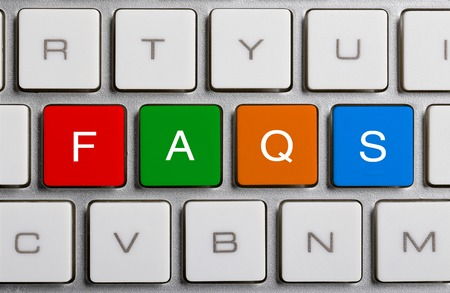 faq's: FAQS text on the colorful buttons of the keyboard.
