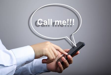 call me: Businessman using smart phone with Call me speech bubble against gradually varied background.