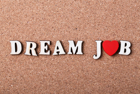 dream job: Dream job concept on the wooden cork background.