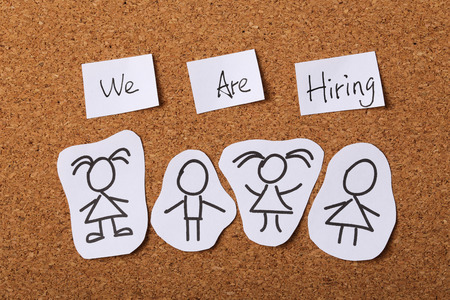 jobless: We are hiring concept with wooden cork background.