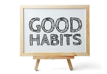good habits: Small whiteboard with text Good Habits is isolated on white background. Stock Photo
