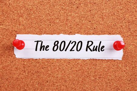 corkboard: Text The 80 20 Rule written on note paper pinned on the corkboard.
