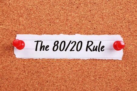 majority: Text The 80 20 Rule written on note paper pinned on the corkboard.