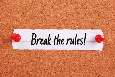 break the rules: Text Break The Rules written on note paper pinned on the corkboard.