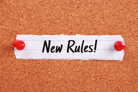 new rules: Text New Rules written on note paper pinned on the corkboard.