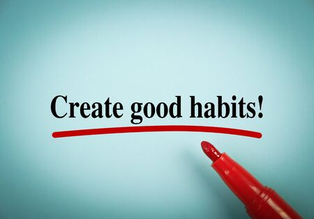 good habits: Text Create Good Habits with red underline on the light blue background. Stock Photo