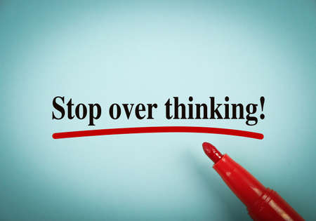 underline: Text Stop Over Thinking with red underline on the light blue background. Stock Photo