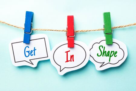 get in shape: Paper speech bubbles with text Get In Shape hanging on the line.