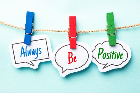 always: Paper speech bubbles with text Always Be Positive hanging on the line.