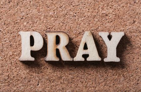 repentance: Wooden pray text is on the corkboard background. Stock Photo