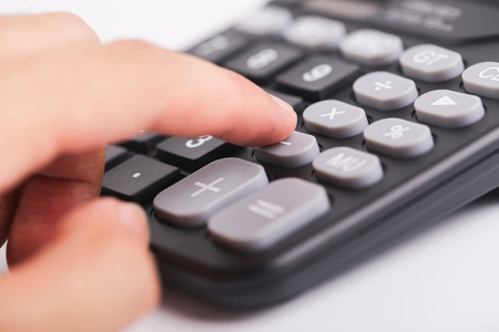 cpa: The man is using the black calculator with white background.