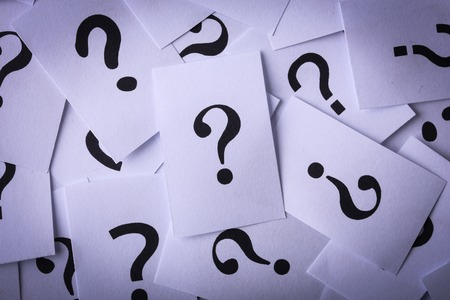 undetermined: Closeup shot of a lot of paper with Question mark.