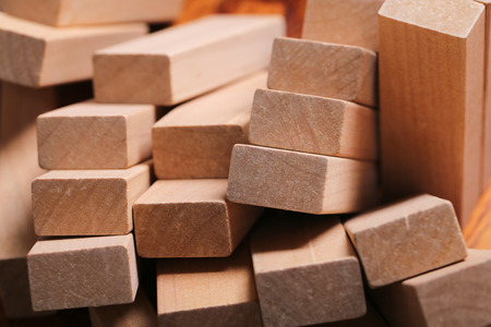 buildup: Wooden blocks are on the wooden floor background.