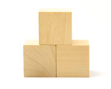 establishes: Wooden blocks are isolated on white background. Stock Photo