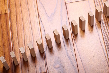 flick: A lot of wooden block standing in a line.