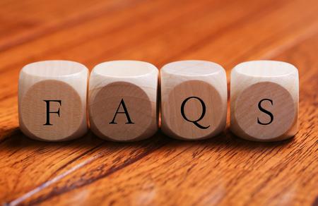 faq's: FAQS word wooden blocks are on the floor. Stock Photo