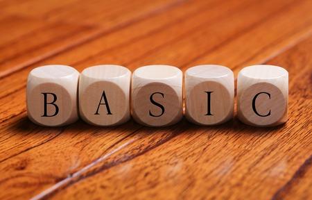 basic: BASIC word wooden blocks are on the floor.