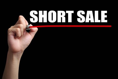 short sale: Hand is drawing a red line under the text Short Sale with black background.