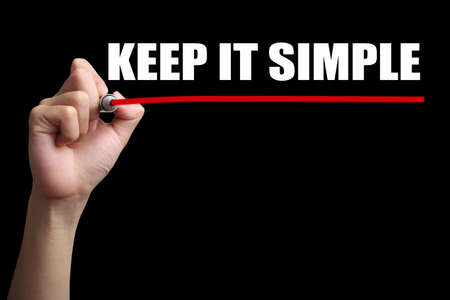 cogent: Hand is drawing a red line under the text Keep It Simple with black background.