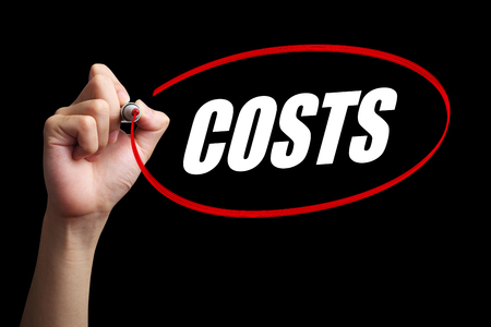 economize: Hand is drawing a red circle around the word Costs with black background. Stock Photo