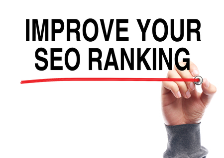 meta analysis: Hand drawing the red line under the text Improve Your SEO Ranking isolated on white. Stock Photo