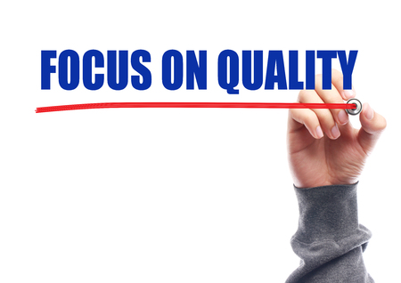 customer focus: Hand drawing the red line under the text Focus On Quality isolated on white.