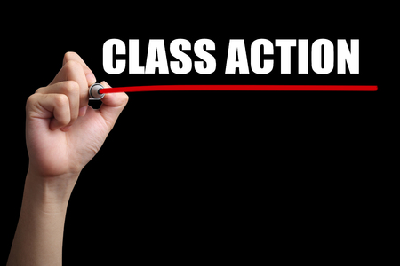 prosecute: Hand is drawing a red line under the text Class Action with black background.