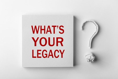 Red text What is Your Legacy and paper question mark with white background. Banque d'images