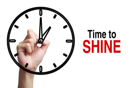 time to shine: Hand is drawing a clock with text Time To Shine Concept aside isolated on white background.