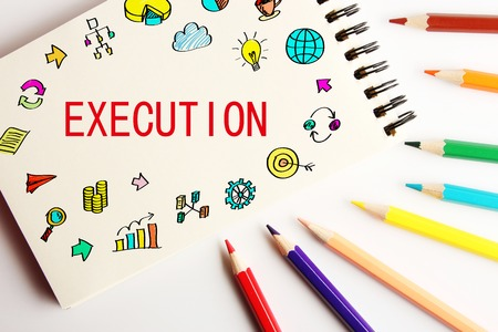 execution: Execution business concept on the note with some colorful pencils aside.