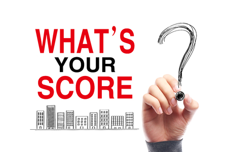 quizzing: What is Your Score with a big question mark drawn by the hand with black mark.