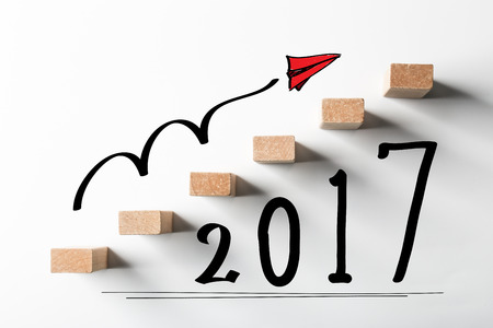 rises: Concept of new year 2017 ahead for background used.