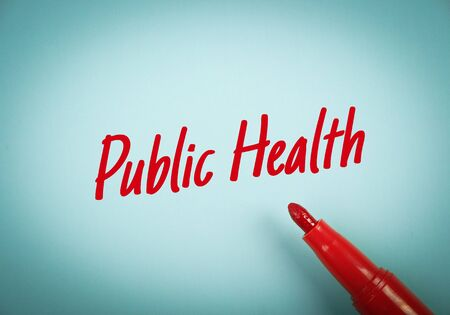 public health: Text Public Health written on blue paper with red mark pen aside.