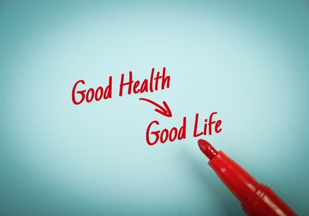 mark pen: Text Good Health Results Good Life written on blue paper with red mark pen aside.