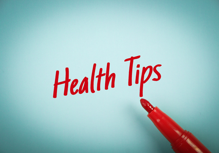 mark pen: Text Health Tips written on blue paper with red mark pen aside.