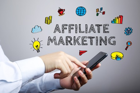 affiliate: Affiliate Marketing business concept with businessman touching the smartphone.