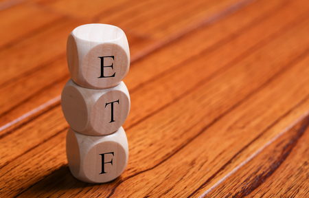 ETF wooden blocks are on the wooden floor background.