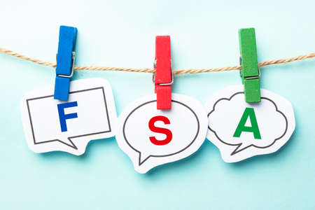 flexible business: FSA word bubble paper is hanging on the line. Stock Photo