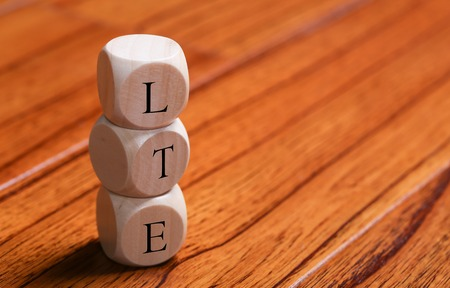 LTE wooden blocks are on the wooden floor background. Stock Photo
