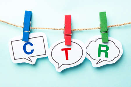 advertiser: CTR word bubble paper is hanging on the line. Stock Photo