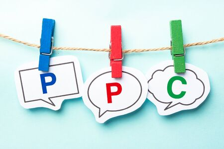 keywords bubble: PPC word bubble paper is hanging on the line.