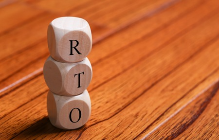 disruption: RTO wooden blocks are on the wooden floor background.