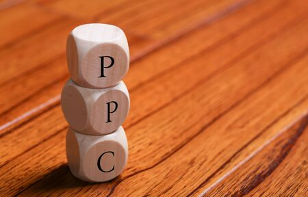 ppc: PPC wooden blocks are on the wooden floor background.