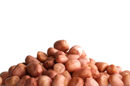 goober: Pile of peanuts with skin isolated on white.