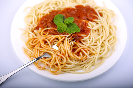 Spaghetti with minced beef tomato sauce and fresh basil.