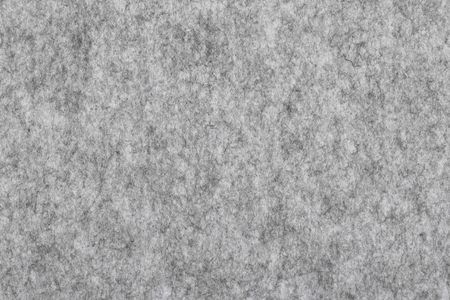 Grey felt textured background.