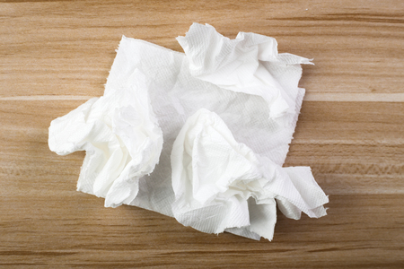 Tissue on the wooden table background.